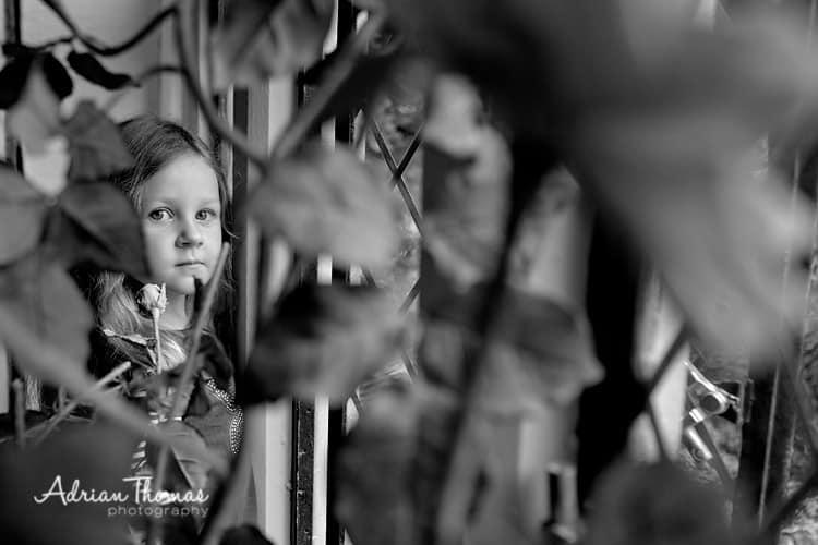 Brdiesmaid looking at rian through window