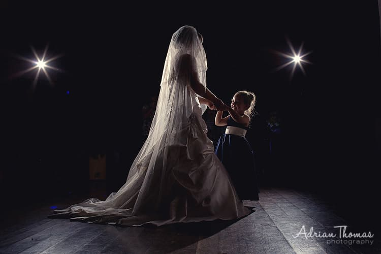 Bride dances with daughter at wedding