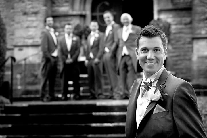 Groom standing in front of ushers