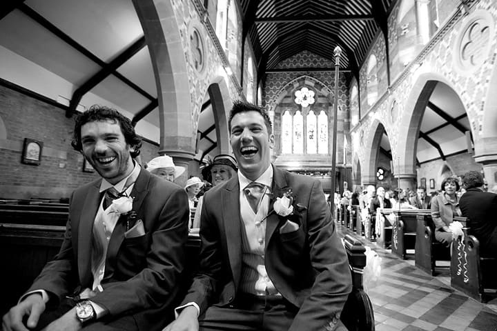 Laughing groom and bestman
