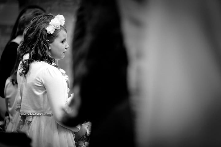 Bridesmaid during wedding service