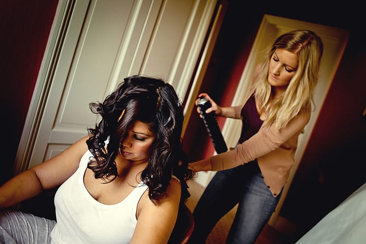 Bride having her hair done for wedding