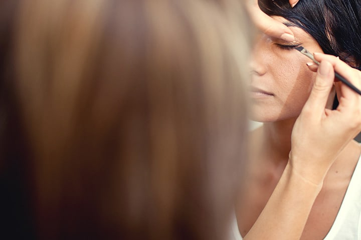 makeup artist preparing bride