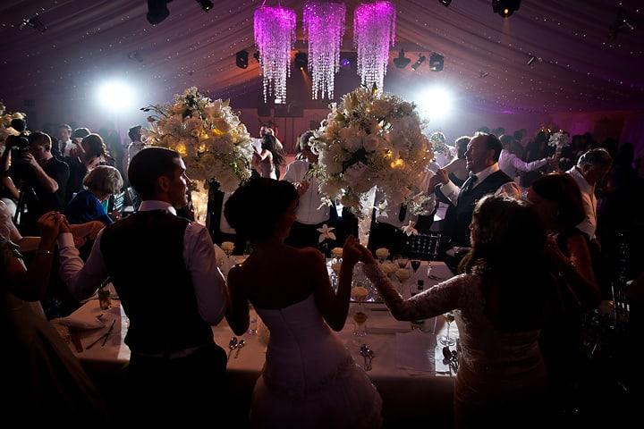Wedding couple and guests enjoying wedding entertainment