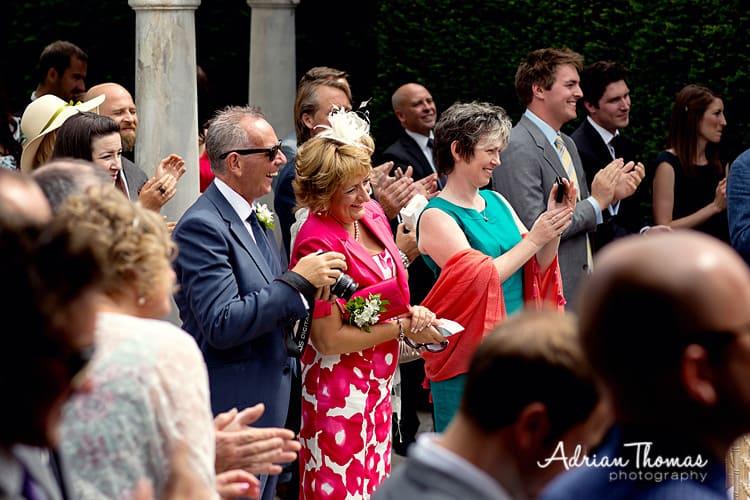 Guests congratulate bride and groom
