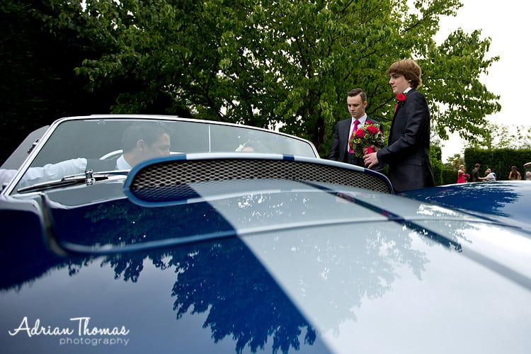 usher helps bride into car