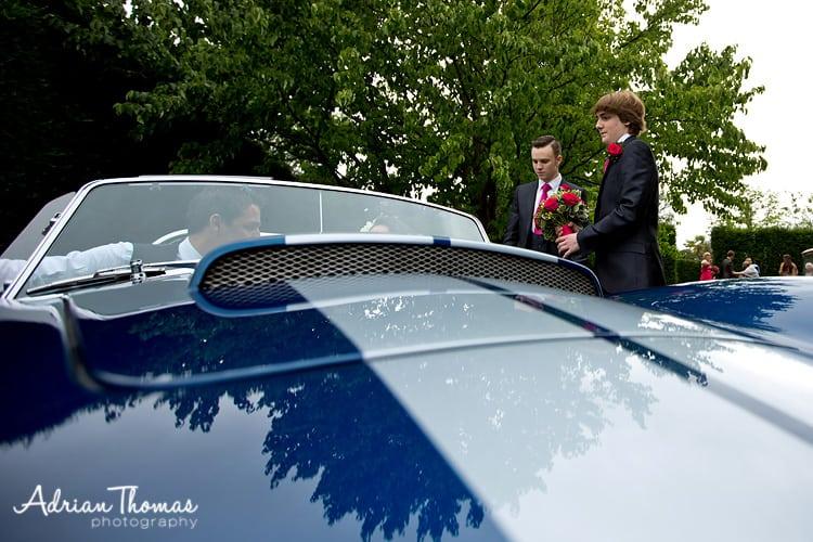 usher helps bride into car
