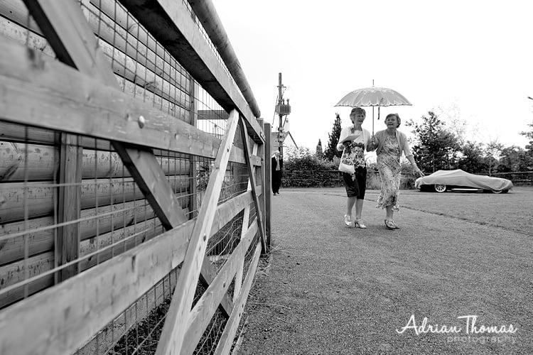 Guests arrive in rain at Vineyard