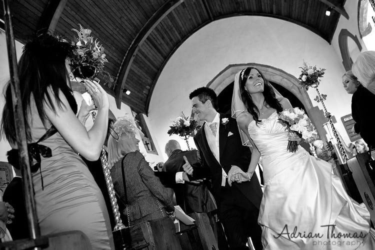 Bride and groom walking up aisle