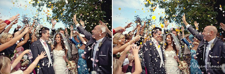 Guests throwing confetti at St Edeyrns Church