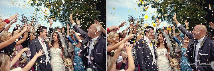 Guests throwing confetti at St Edeyrns Church