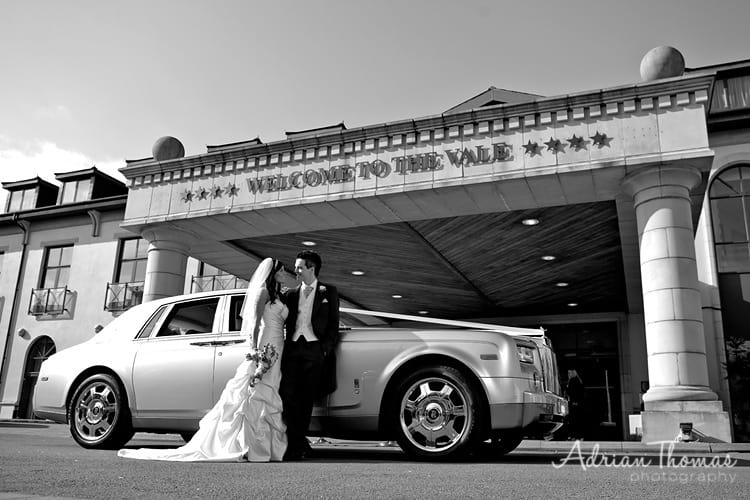 Bride and Groom with wedding car outside The Vale Hotel and Resort