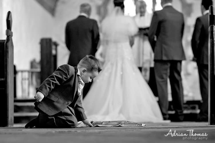 Wedding pageboy plays during service