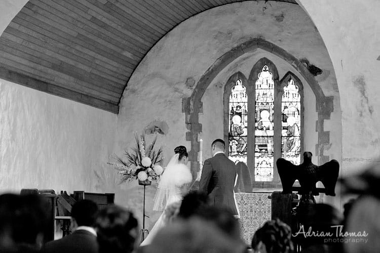 Wedding couple during service