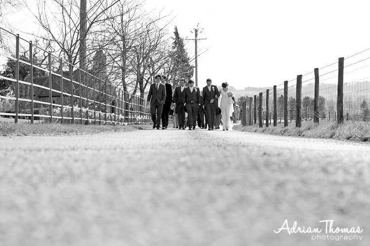 Guests walk to wedding reception