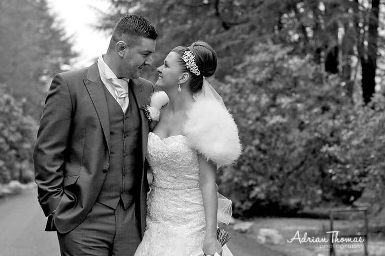 Photograph of bride and grrom in drive way at Maes Manor Hotel