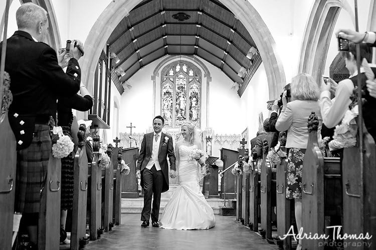 Married couple walking with the isle