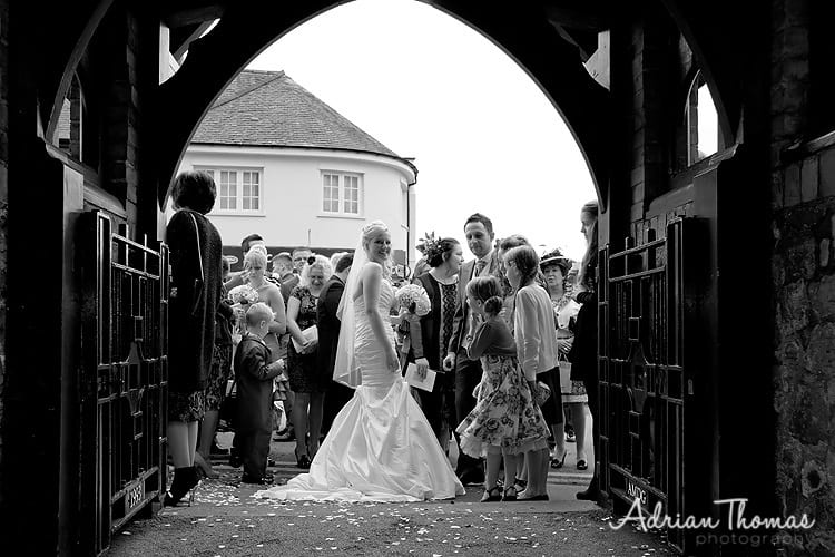Happy couple at wedding gate