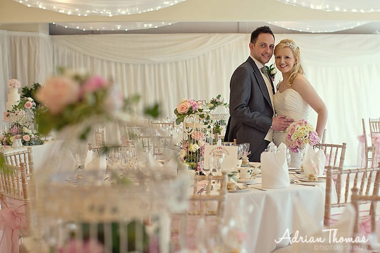 Bride and groom inside marquee reception at New House Country Hotel