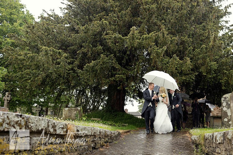 Bride and groom with umbrella.