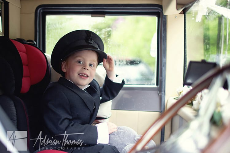 Pageboy wearing drivers cap.