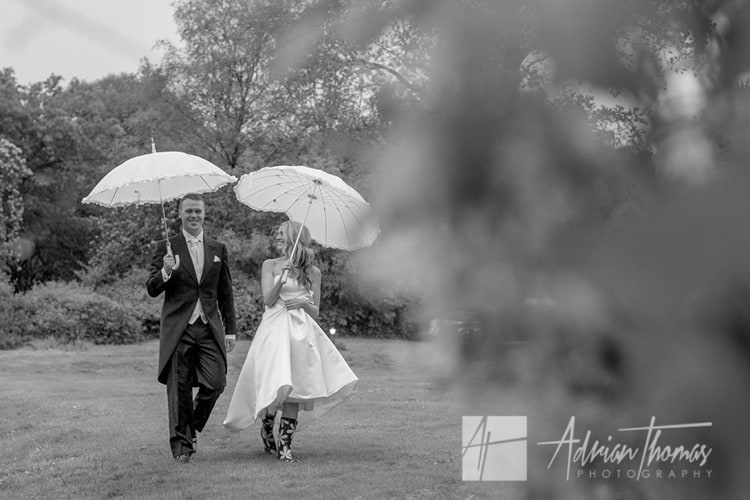 Bride and groom out in the rain.