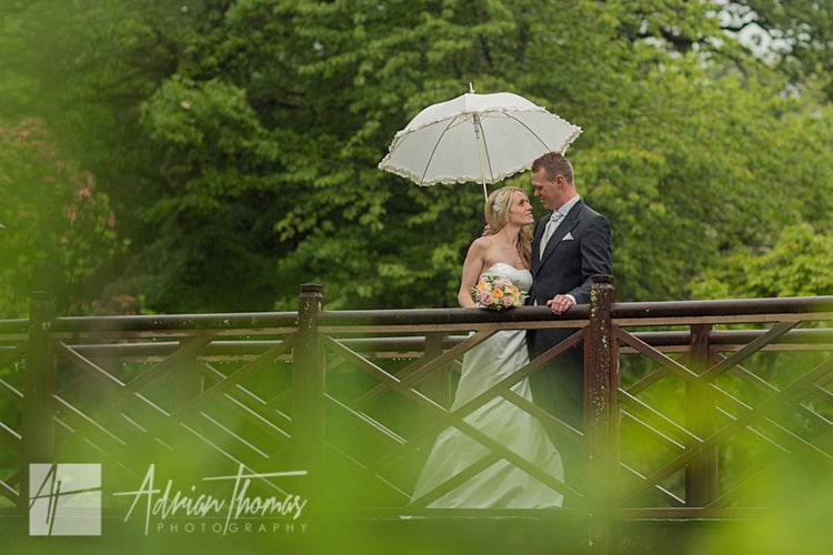 Bride and groom in the rain.