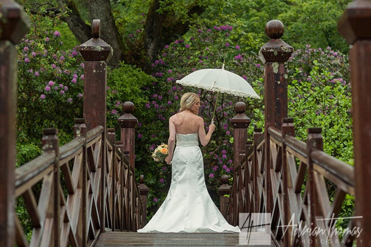 Image of brides and dress at Bryngarw House wedding on bridge.