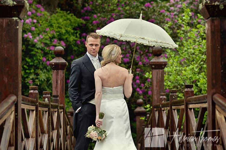 Image of bride and groom on bridge at Bryngarw House in Bridgend