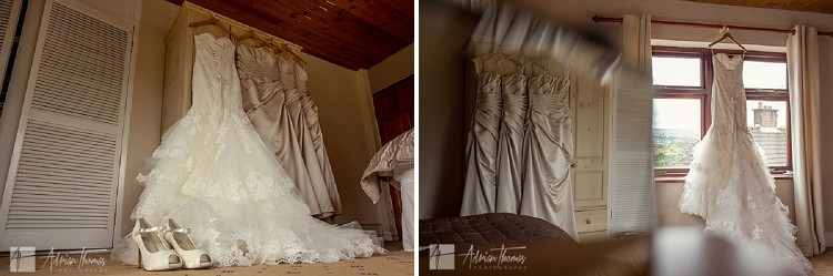 Brides and bridesmaids dresses on hangers.