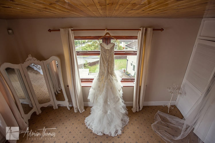 Brides dress hanging up.