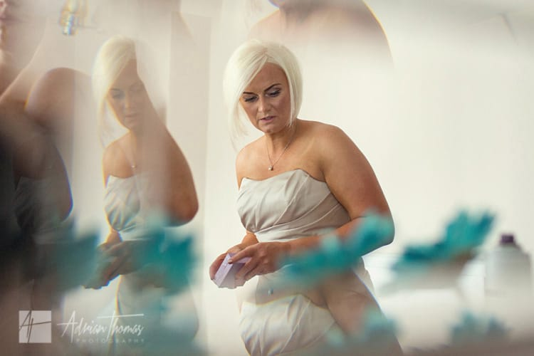 Bridesmaid in the mirror.