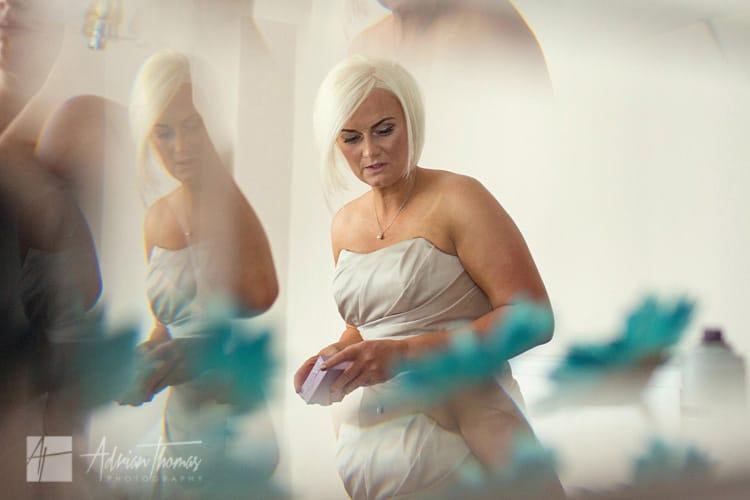 Bridesmaid in the mirror.