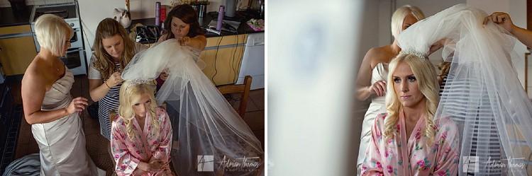 Bride having her veil applied.