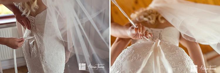 Brides dress being fastened.