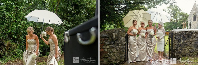 Bridesmaids arrive at Llanilid Church in rain.