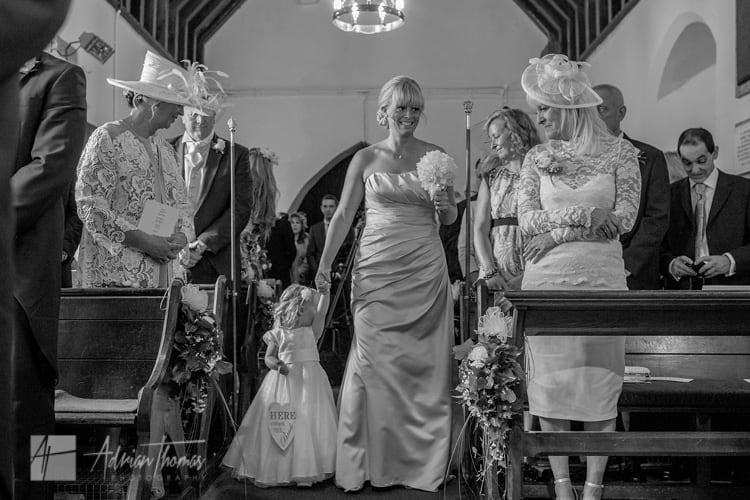Bridesmaids walking down isle.