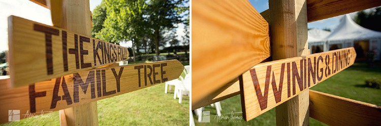 Wooden signs with directions of wedding areas.
