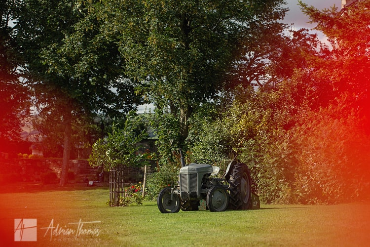 Family tractor used as prop at wedding.