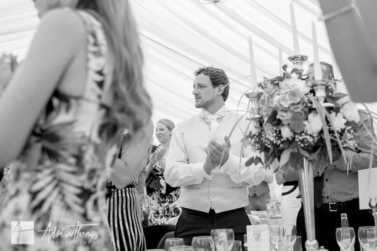 guest inside wedding reception marquee.