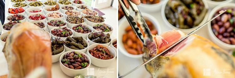 Wedding food display inside marquee reception.