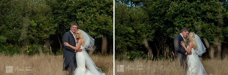 Image of bride and groom portrait in field near Llanilid Church.
