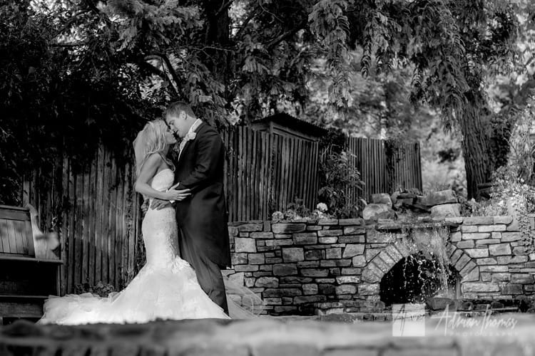 Portrait image of married couple kissing Llanilid Church.