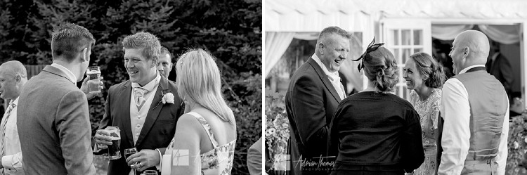 Groom and guest laughing during wedding reception.
