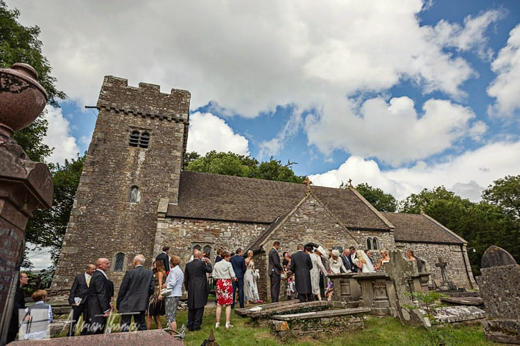 Guests mingle outside Llanilid Church.
