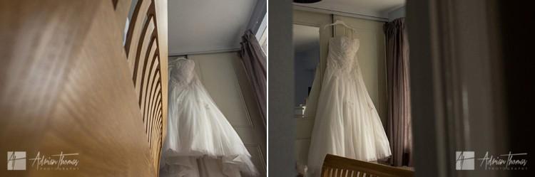 Bride dress hanging up.