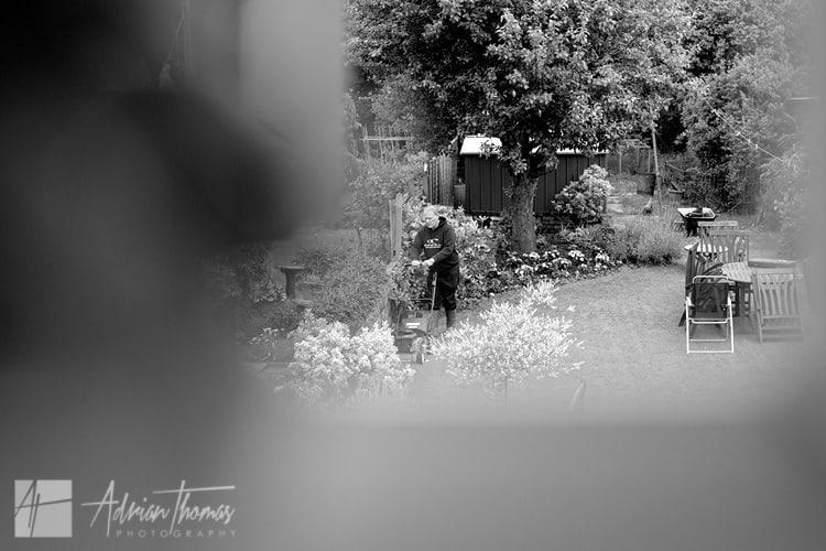 Brides dad mowing lawn before wedding.