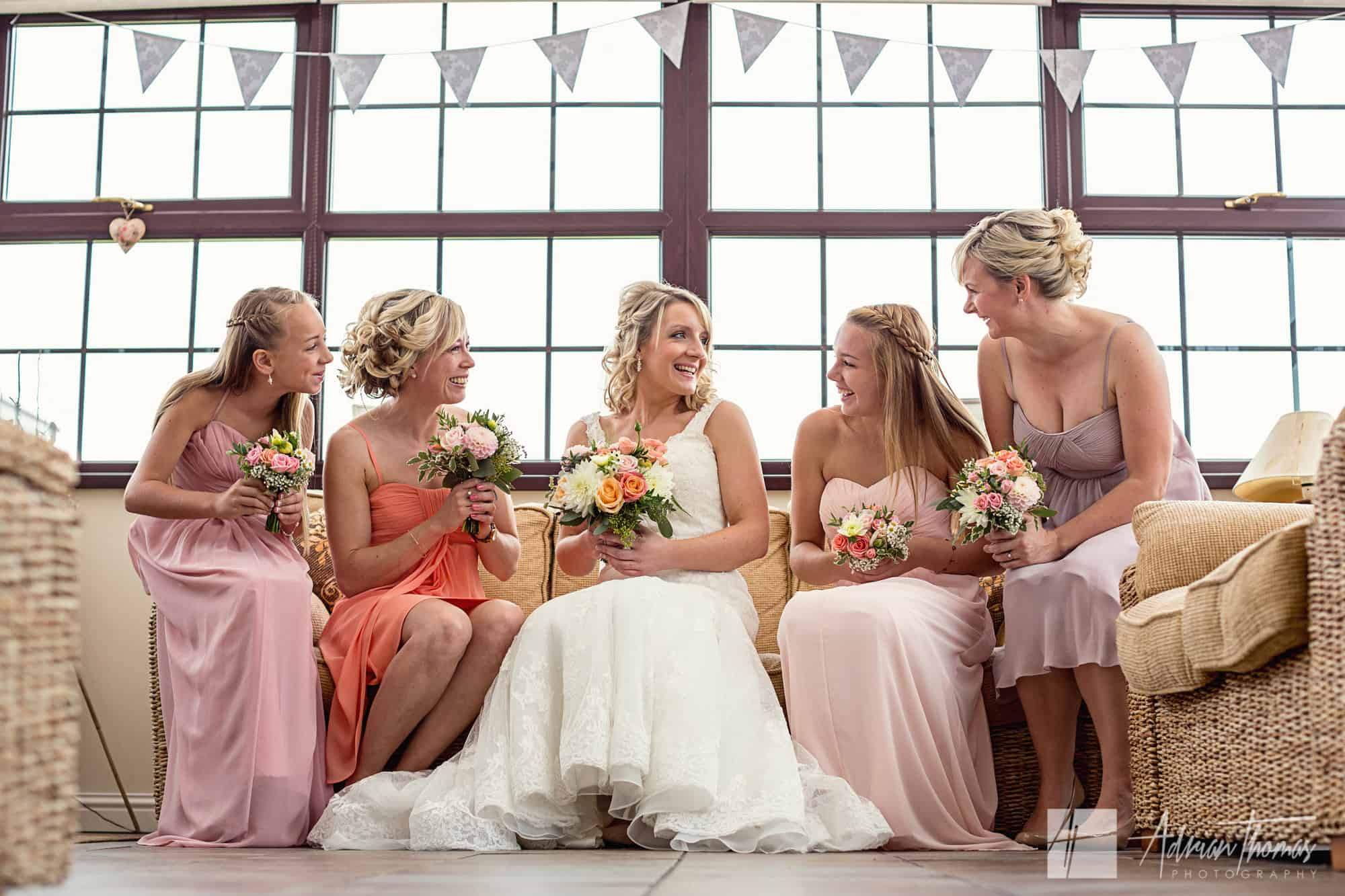 Bride and Bridesmaids chatting before wedding at Pentre Tai Farm in Bassaleg.