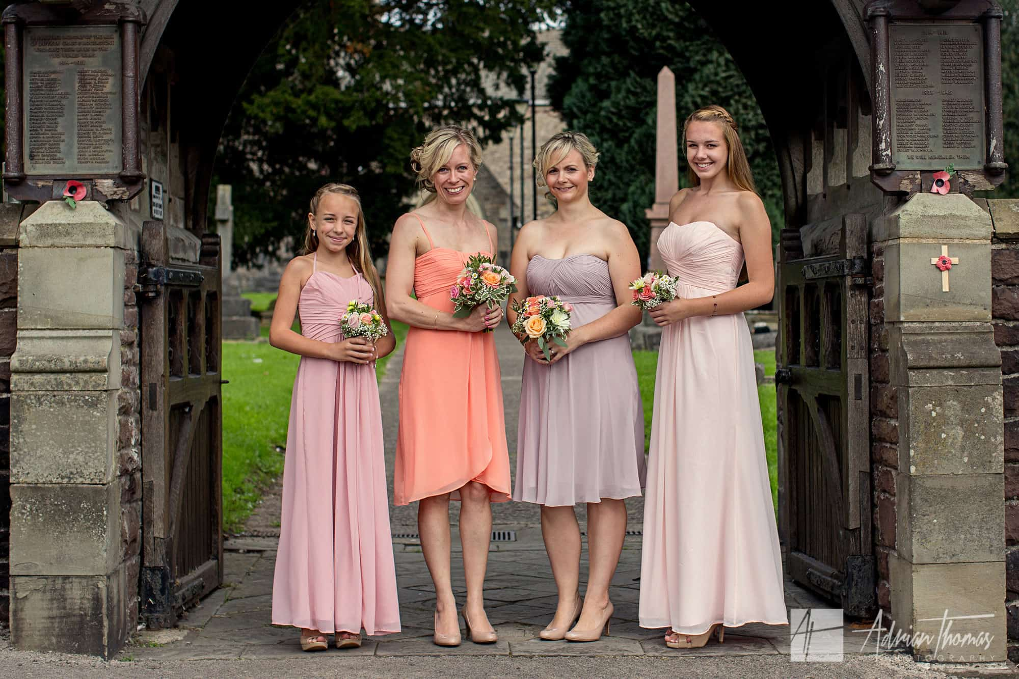 Bridesmaids outside St Basils Church in Bassaleg near Caerphilly.