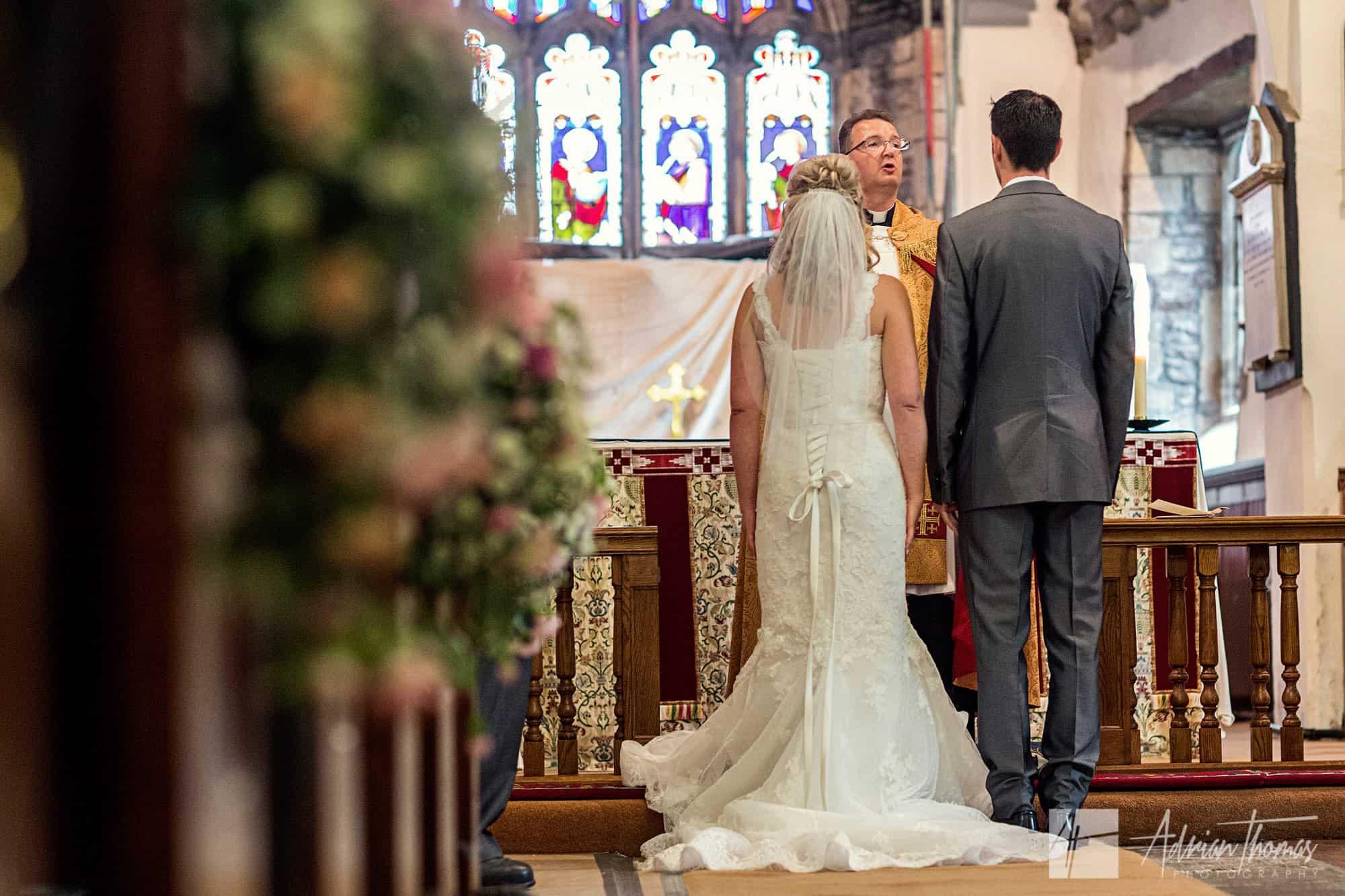 Photograph of wedding couple shot from isle.